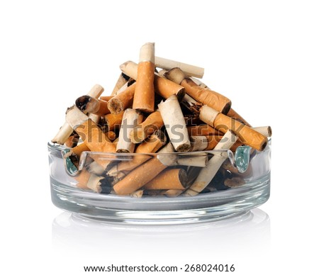 Cigarette butts in the ashtray on white - stock photo
