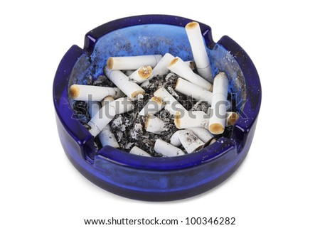 cigarette ends in blue ashtray isolated - stock photo