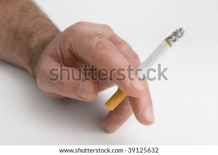 Cigarette in a hand on white