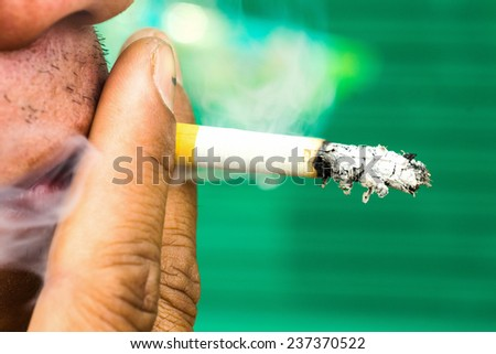Cigarette in mouth. Bad habit, addiction, problems with health