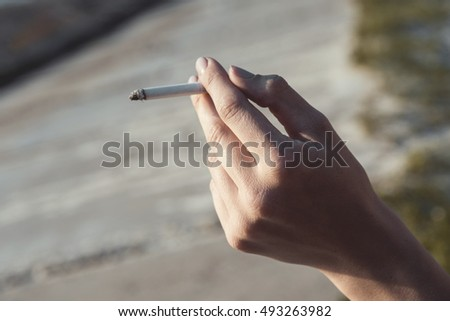 Cigarette in the hands of woman