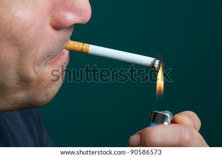 Cigarette lighting up, last one - stock photo
