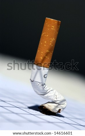 cigarette off on background nuanced - stock photo