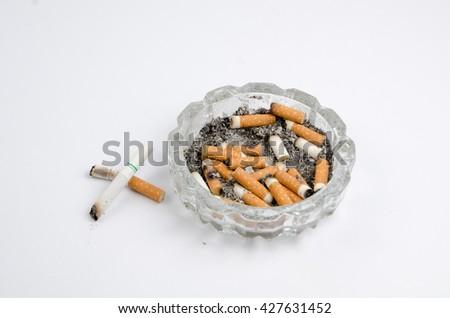 Cigarette  on a white background - stock photo