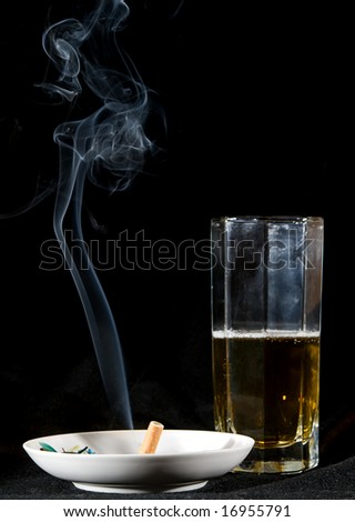 cigarette smoke and beer drink - stock photo