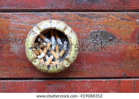 Cigarette, Smoking, Pollution, Smoking, Danger. Ashtray with stub on the table with top view - stock photo