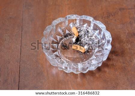 cigarette stub in ashtray - stock photo