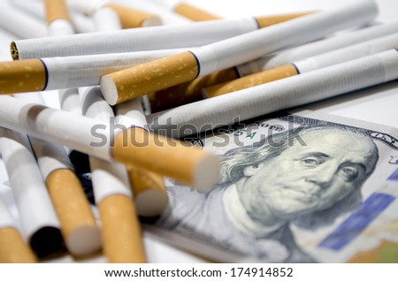 Cigarettes and dollar as aconcept of smoking costs - stock photo