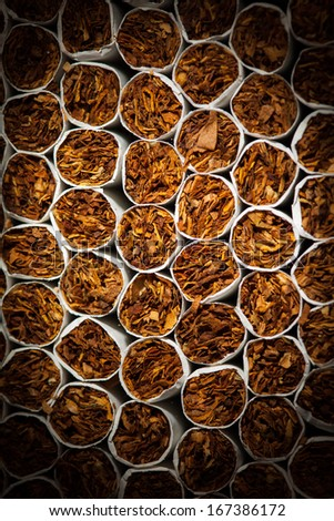 cigarettes background with spotlight, closeup view