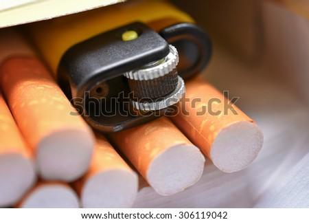 Cigarettes box and lighter - stock photo