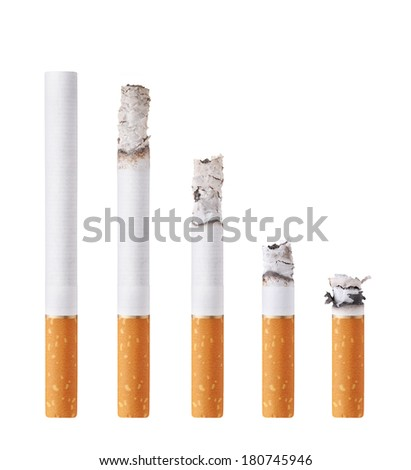 Cigarettes during different stages of burn. Isolated on white - stock photo