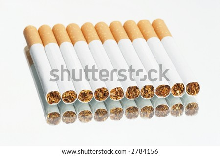 cigarettes in a row on a mirror - white background