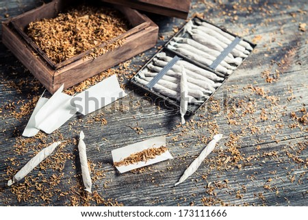 Cigarettes made �¢??�¢??from tobacco and tablets - stock photo