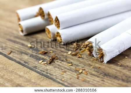 cigarettes on wooden - stock photo