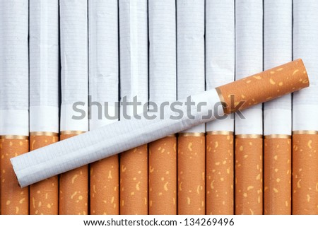 Cigarettes with a brown filter close up - stock photo