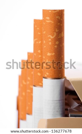 Cigarettes with a brown filter  in the box close up