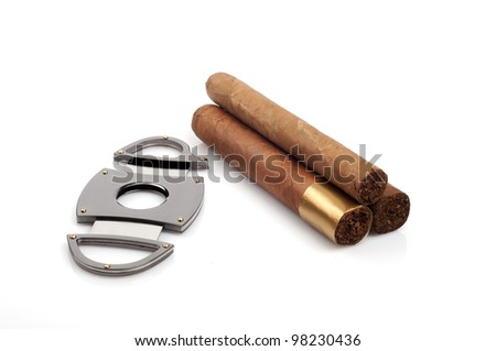 Cigars and a open cutter isolated on white background - stock photo