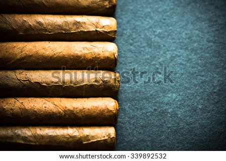 Cigars border background with copy space - stock photo