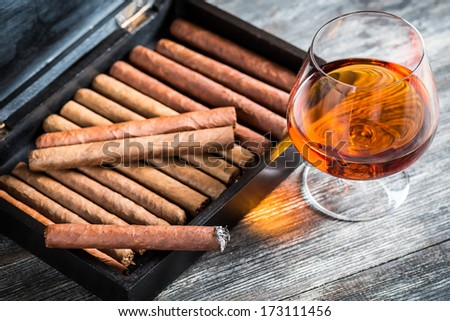 Cigars in humidor and cognac - stock photo