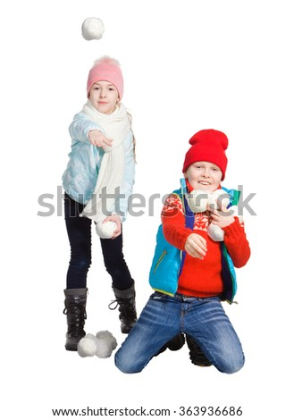 Cildren playing in the snow - stock photo