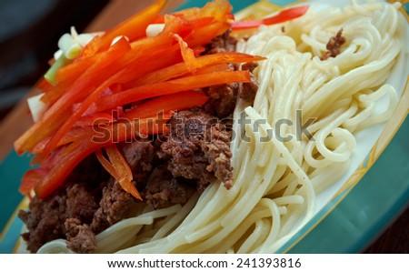 Cincinnati chili - regional style of chili con carne. ingredient chili, spaghetti, paprika , diced onions - stock photo
