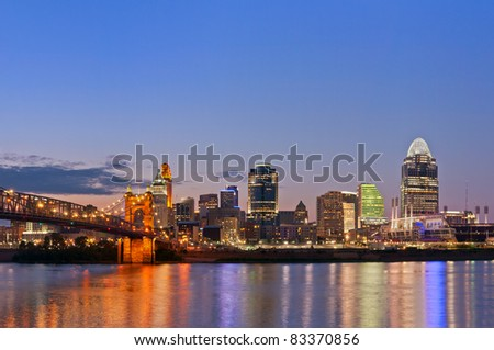 Cincinnati skyline. Image of Cincinnati and John A. Roebling suspension bridge at twilight. - stock photo