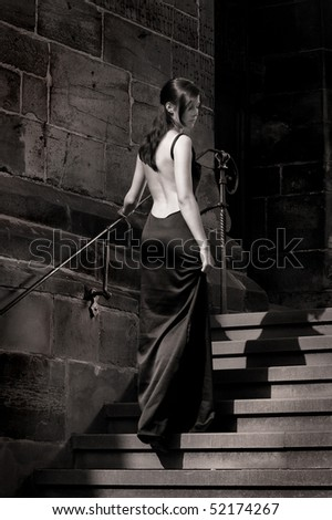 Cinderella wearing an evening dress - stock photo