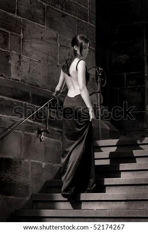 Cinderella wearing an evening dress - stock photo