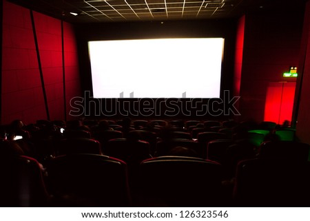 Cinema auditorium with screen and seats - stock photo