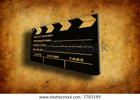 cinema clapboard over old and worn paper texture - stock photo