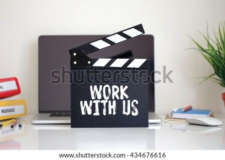 Cinema Clapper with Work With Us word - stock photo