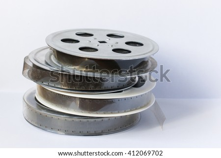 cinema film 35 mm on a light background - stock photo