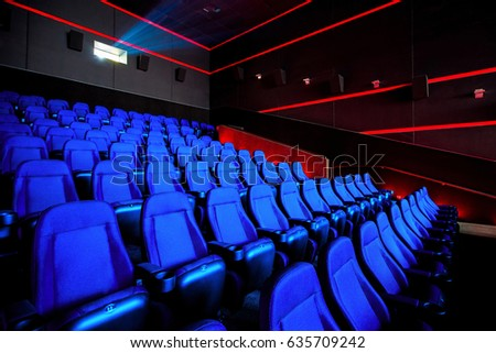 Cinema hall, movie theater, rows of blue chairs in theatre. Copy space for your design