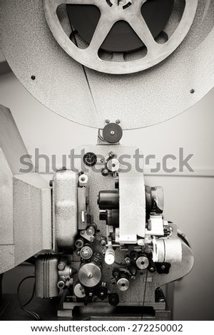 Cinema projector for 16 mm movie, old vintage  professional industrial machine with reel in black and white - stock photo