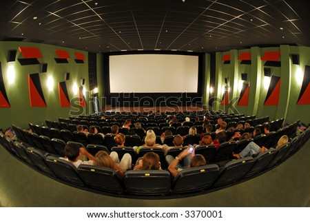 Cinema red seats in cinema hall 3 - stock photo