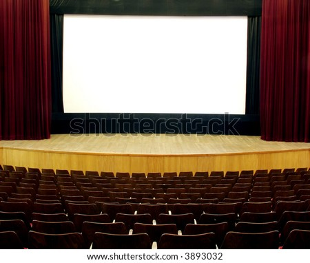 cinema, wooden seats and stage, red velvet curtain, white empty screen
