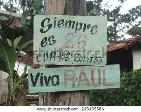 Cinfuegos, Cuba, August 13, 2012: Cuba's politic propaganda. A wall script in favour of the revolution.  - stock photo