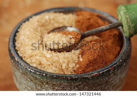 Cinnamon and Sugar, macro with shallow depth of field - stock photo