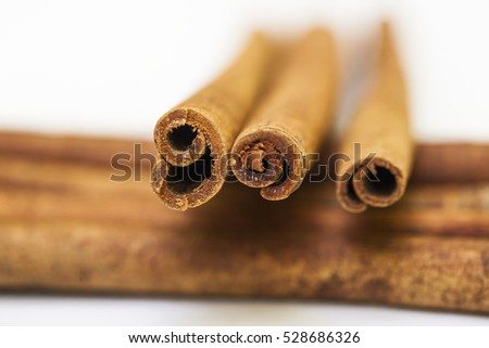cinnamon background. close up cinnamon stick on white background