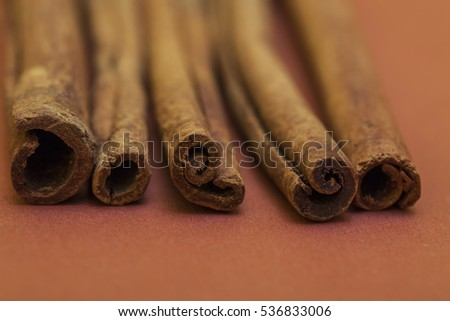 cinnamon background. close up cinnamon stick on yellow background