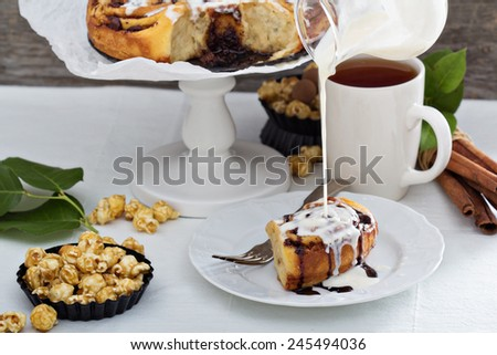 Cinnamon buns with chocolate and cream cheese glaze - stock photo