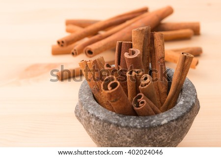 Cinnamon fragrant strike to food dishes, desserts and drinks. To add to the effects of food on the wooden floor. - stock photo