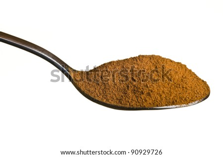 Cinnamon in a spoon isolated over white background - stock photo