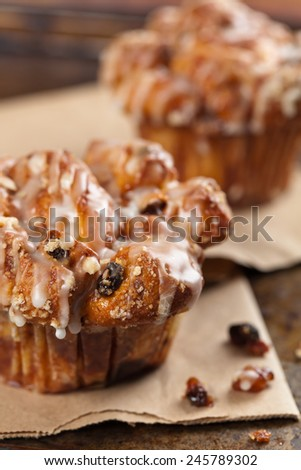 Cinnamon Raisin Cobblestone Muffins made from swirl bread dough . Selective focus. Shallow DOF. - stock photo