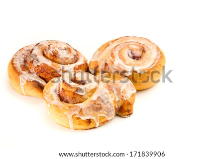 Cinnamon Roll - This is a photo of a tasty cinnamon roll coated in icing. Shot with a shallow depth of field on an isolated white background. - stock photo