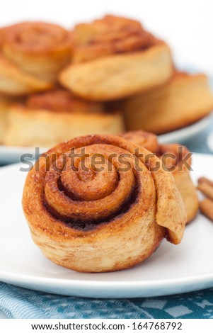 Cinnamon rolls group on white plate - stock photo
