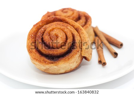 Cinnamon rolls on a plate, white background - stock photo