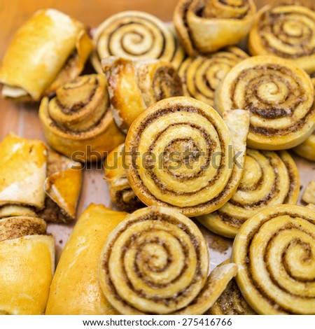 Cinnamon Rolls: small spiral twisted buns stuffed with a buttery cinnamon and brown sugar cream. - stock photo
