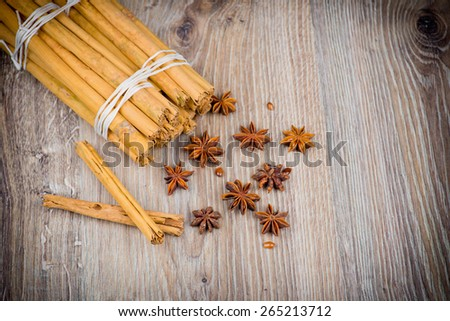 Cinnamon stick and star anise on wooden background