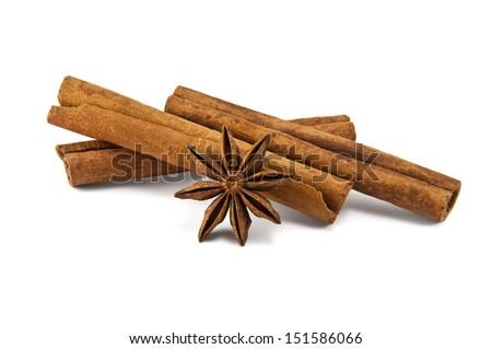 Cinnamon sticks and anise stars on white - stock photo